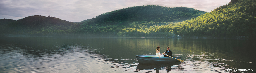 Row boat ride after a wedding ceremony in the heart of the Adirondacks