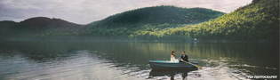 Rowboat ride after a wedding ceremony in the heart of the Adirondacks